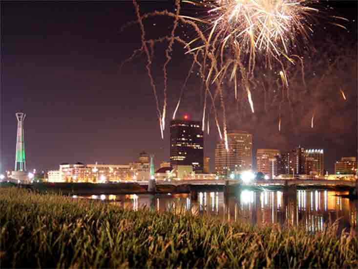 city landscape with fireworks in the background